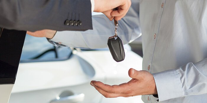 Man handing over keys